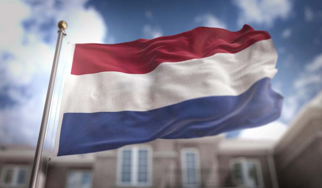 Netherlands Flag 3D Rendering on Blue Sky Building Background